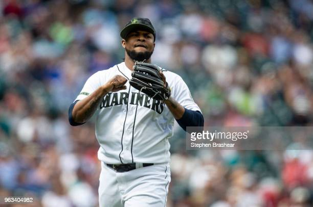 Relief pitcher Alex Colome of the Seattle Mariners reacts after pitching during the eighth inning of a game against the Texas Rangers at Safeco Field...