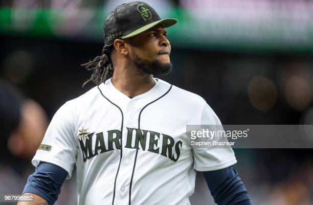 Relief pitcher Alex Colome of the Seattle Mariners walks off the field during a game against the Texas Rangers at Safeco Field on May 28 2018 in...