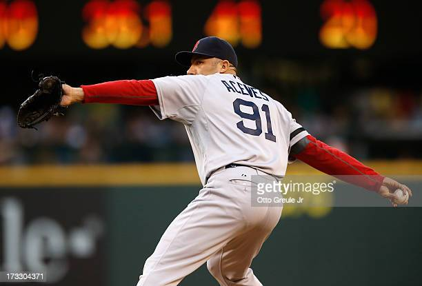Relief pitcher Alfredo Aceves of the Boston Red Sox pitches against the Seattle Mariners at Safeco Field on July 9 2013 in Seattle Washington