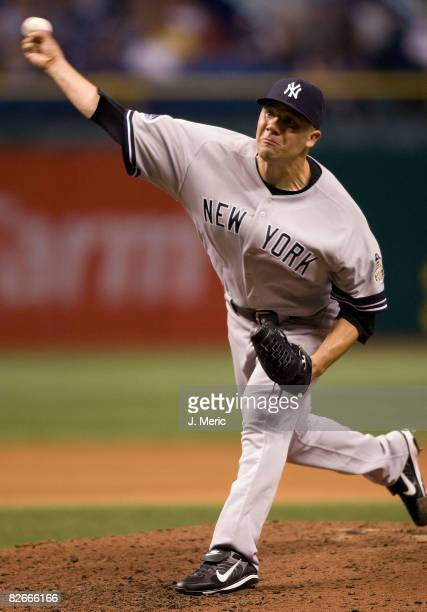 Relief pitcher Alfredo Aceves of the New York Yankees pitches against the Tampa Bay Rays during the game at Tropicana Field September 4 2008 in St...
