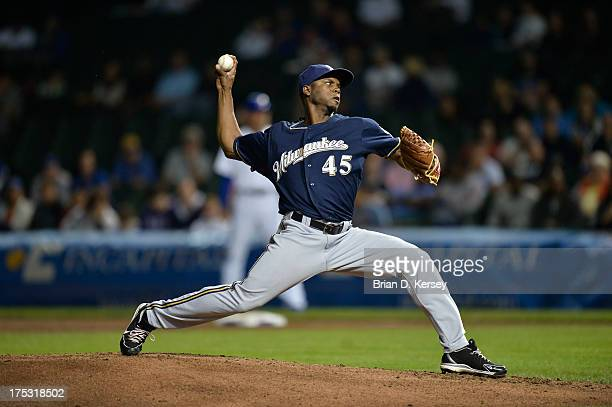 Relief pitcher Alfredo Figaro of the Milwaukee Brewers delivers against the Chicago Cubs at Wrigley Field on July 31 2013 in Chicago Illinois The...