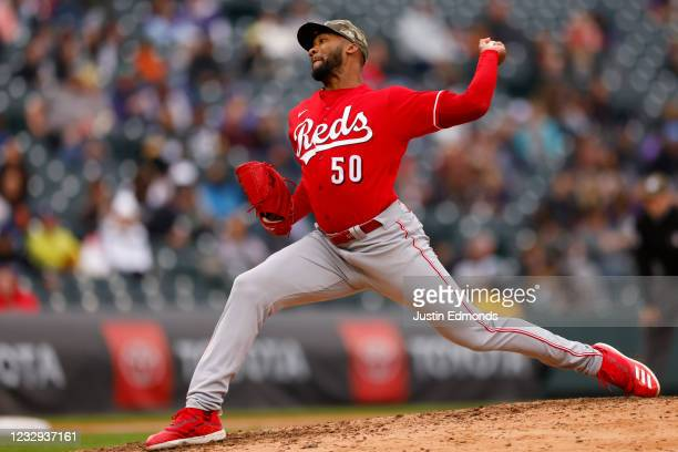 Relief pitcher Amir Garrett of the Cincinnati Reds delivers to home plate during the sixth inning against the Colorado Rockies at Coors Field on May...