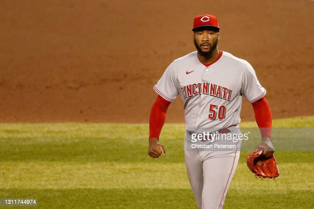 Relief pitcher Amir Garrett of the Cincinnati Reds reacts after defeating the Arizona Diamondbacks in the MLB game at Chase Field on April 09, 2021...