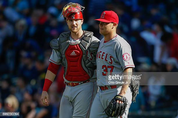 Relief pitcher Andrew Bailey of the Los Angeles Angels of Anaheim is congratulated by catcher Jett Bandy after beating the Seattle Mariners 42 at...