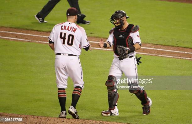 Relief pitcher Andrew Chafin of the Arizona Diamondbacks celebrates with catcher Jeff Mathis after defeating the Chicago Cubs in the MLB game at...