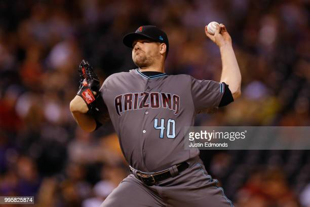 Relief pitcher Andrew Chafin of the Arizona Diamondbacks delivers to home plate during the ninth inning against the Colorado Rockies at Coors Field...