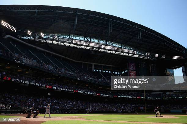Relief pitcher Andrew Chafin of the Arizona Diamondbacks pitches against Yasmani Grandal of the Los Angeles Dodgers during the seventh inning of the...