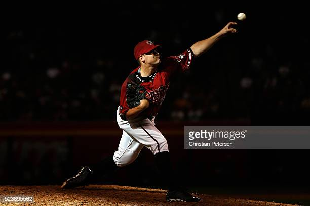 Relief pitcher Andrew Chafin of the Arizona Diamondbacks pitches against the Pittsburgh Pirates during the ninth inning of the MLB game at Chase...