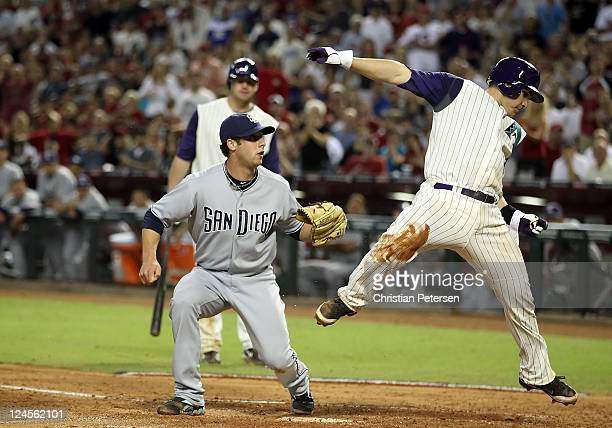 Relief pitcher Anthony Bass of the San Diego Padres tags out Miguel Montero of the Arizona Diamondbacks as he attempts to score during the sixth...