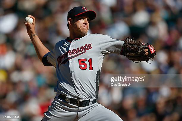 Relief pitcher Anthony Swarzak of the Minnesota Twins pitches against the Seattle Mariners at Safeco Field on July 27 2013 in Seattle Washington The...