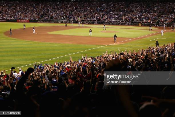Relief pitcher Archie Bradley of the Arizona Diamondbacks celebrates after defeating the Los Angeles Dodgers 65 in the MLB game at Chase Field on...