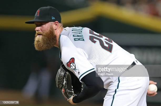 Relief pitcher Archie Bradley of the Arizona Diamondbacks pitches against the Colorado Rockies during the seventh inning of an MLB game at Chase...