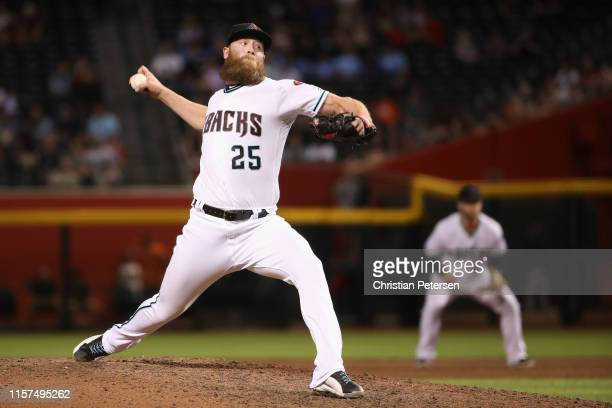 Relief pitcher Archie Bradley of the Arizona Diamondbacks pitches against the San Francisco Giants during the ninth inning of the MLB game at Chase...