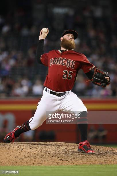 Relief pitcher Archie Bradley of the Arizona Diamondbacks pitches against the Cincinnati Reds during the MLB game at Chase Field on July 9 2017 in...