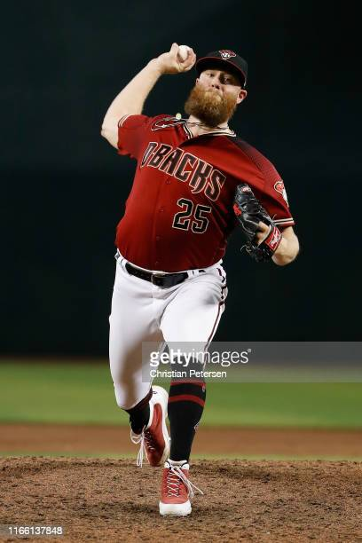 Relief pitcher Archie Bradley of the Arizona Diamondbacks throws a warmup a pitch during the ninth inning of the MLB game against the Washington...