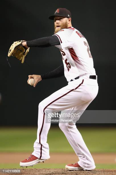 Relief pitcher Archie Bradley of the Arizona Diamondbacks throws a warmup pitch during the MLB game against the Texas Rangers at Chase Field on April...
