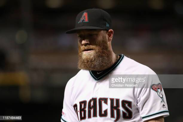 Relief pitcher Archie Bradley of the Arizona Diamondbacks walks off the field during the ninth inning of the MLB game against the San Francisco...
