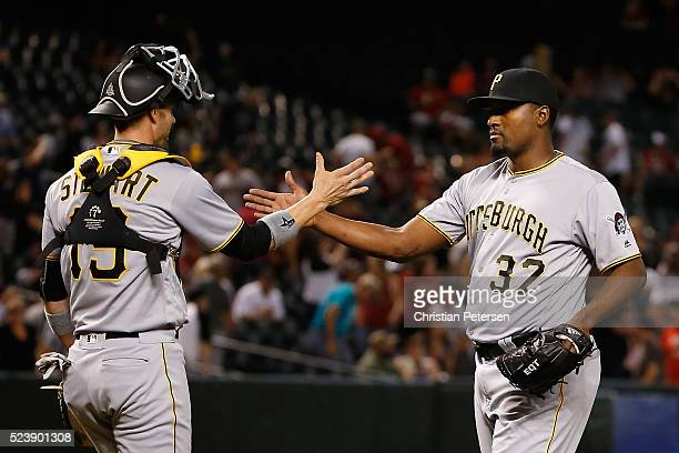Relief pitcher Arquimedes Caminero of the Pittsburgh Pirates celebrates with catcher Chris Stewart after defeating the Arizona Diamondbacks 1210 in...