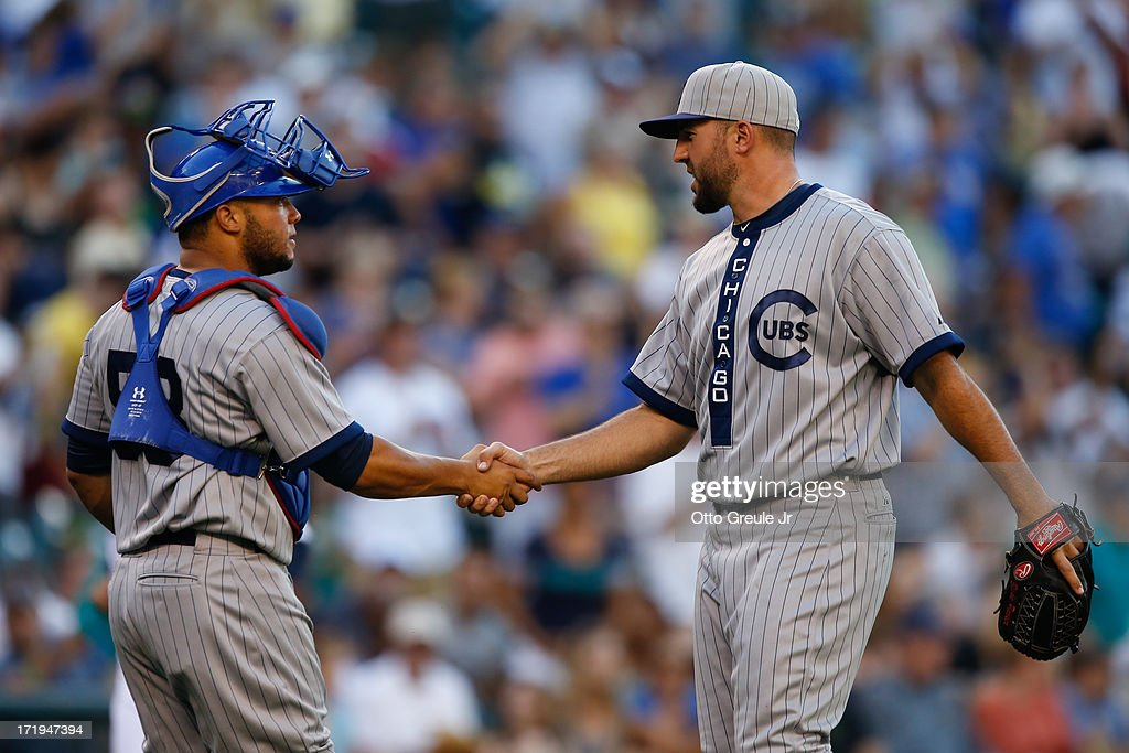 Relief pitcher Blake Parker #50 (R) of the Chicago Cubs is congratulated by catcher Welington Castillo #53 after defeating the Seattle Mariners 5-3 in eleven innings at Safeco Field on June 29, 2013 in Seattle, Washington.