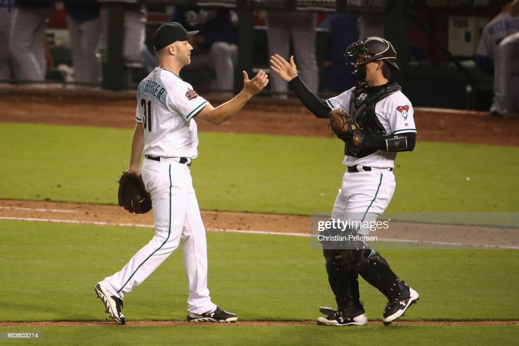Relief pitcher Brad Boxberger #31 of the Arizona Diamondbacks celebrates with catcher John Ryan Murphy #36 after defeating the Los Angeles Dodgers 4-3 in the MLB game at Chase Field on May 1, 2018 in Phoenix, Arizona.