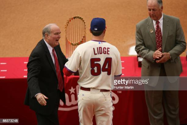 Relief pitcher Brad Lidge of the Philadelphia Phillies receives his World Series ring from Phillies President David Montgomery and GM Pat Gillick...
