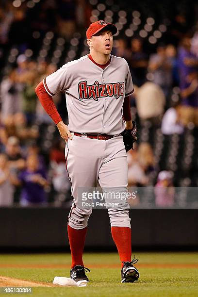 Relief pitcher Brad Ziegler of the Arizona Diamondbacks collects himself after making a throwing error after fielding a ground ball by DJ LeMahieu of...