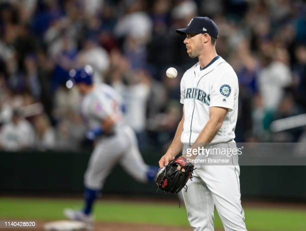 Relief pitcher Brandon Brennan of the Seattle Mariners reacts after giving up a tworun home run Kyle Schwarber of the Chicago Cubs during the eighth...