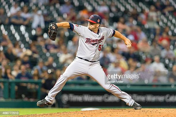 Relief pitcher Brian Duensing of the Minnesota Twins pitches during the eighth inning against the Cleveland Indians at Progressive Field on September...