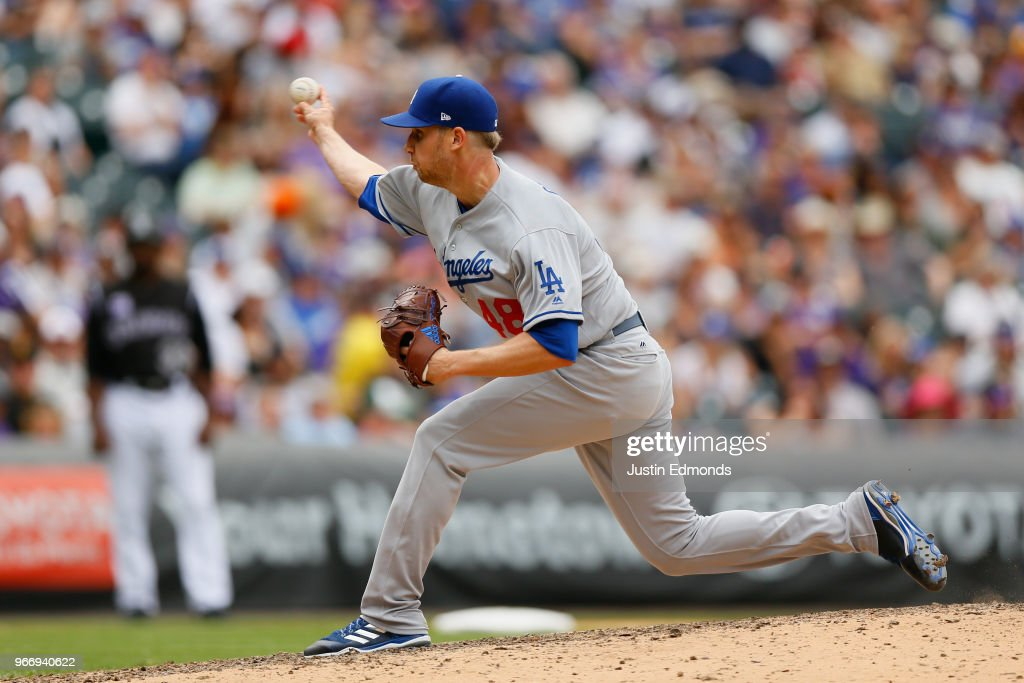 Relief pitcher Brock Stewart #48 of the Los Angeles Dodgers delivers to home plate during the sixth inning against the Colorado Rockies at Coors Field on June 3, 2018 in Denver, Colorado.