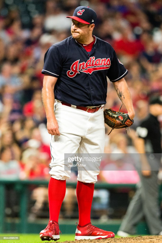 Relief pitcher Bryan Shaw #27 of the Cleveland Indians reacts after giving up a thee run home run during the eighth inning against the Minnesota Twins at Progressive Field on September 26, 2017 in Cleveland, Ohio.