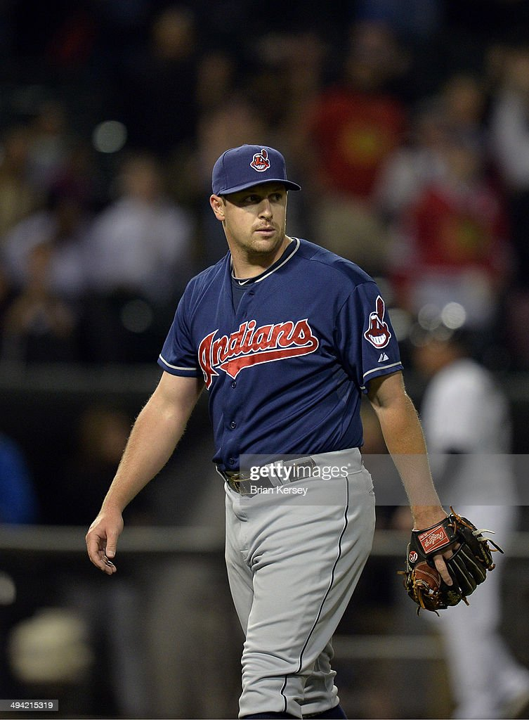 Relief pitcher Bryan Shaw #27 of the Cleveland Indians walks off the field while watching Moises Sierra #25 of the Chicago White Sox celebrate after hitting a game-winning RBI single scoring Leury Garcia during the ninth inning at U.S. Cellular Field on May 28, 2014 in Chicago, Illinois. The White Sox defeated the Indians 3-2.