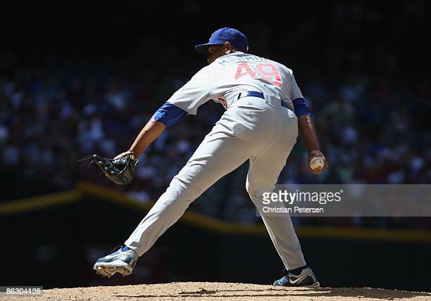 Relief pitcher Carlos Marmol of the Chicago Cubs pitches against the Arizona Diamondbacks during the game at Chase Field on April 29 2009 in Phoenix...