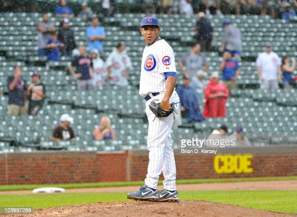 Relief pitcher Carlos Marmol of the Chicago Cubs stands on the mound after giving up a grand slam to Derrek Lee of the Pittsburgh Pirates scoring...
