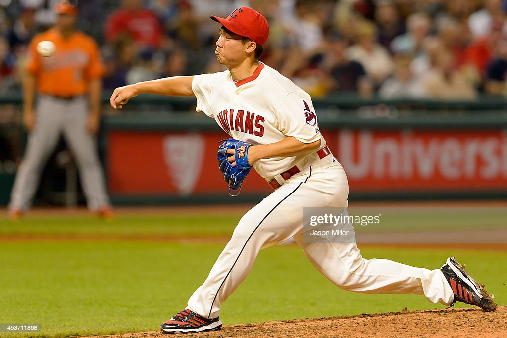 Relief pitcher Chen-Chang Lee #20 of the Cleveland Indians pitches during the eighth inning against the Baltimore Orioles at Progressive Field on August 16, 2014 in Cleveland, Ohio.