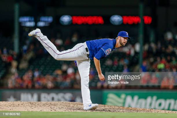 Relief pitcher Chris Martin of the Texas Rangers throws during the ninth inning of a baseball game against the Houston Astros at Globe Life Park July...