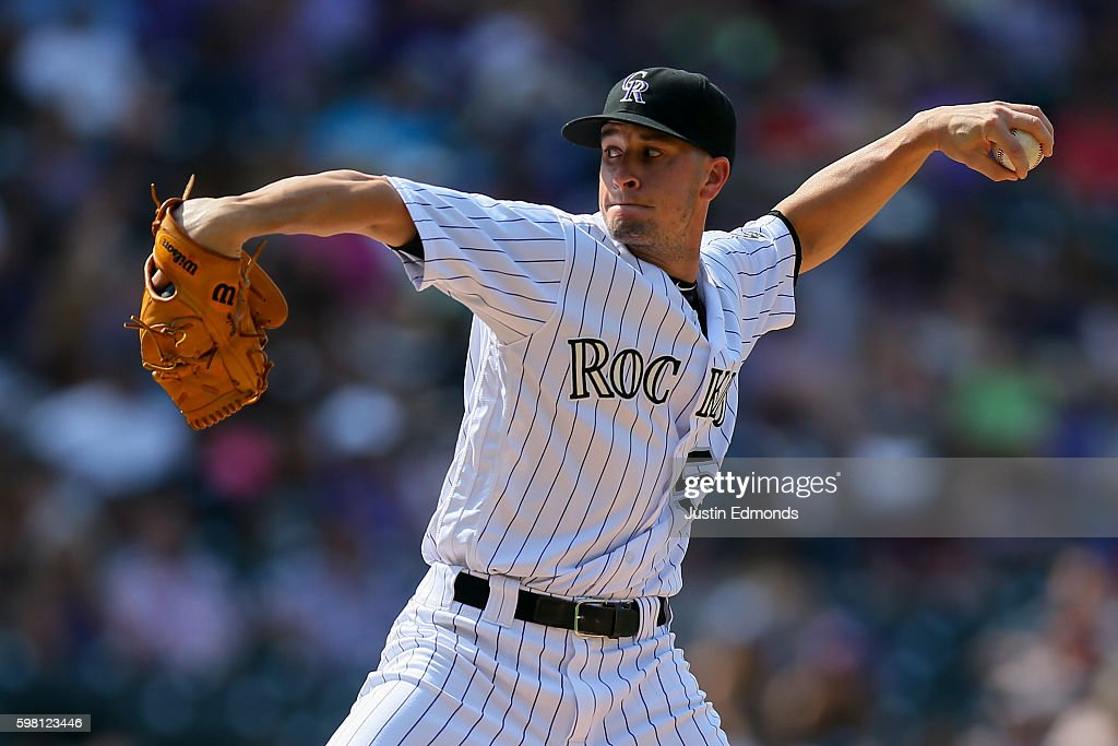 Relief pitcher Chris Rusin #52 of the Colorado Rockies delivers to home plate during the seventh inning against the Los Angeles Dodgers at Coors Field on August 31, 2016 in Denver, Colorado.