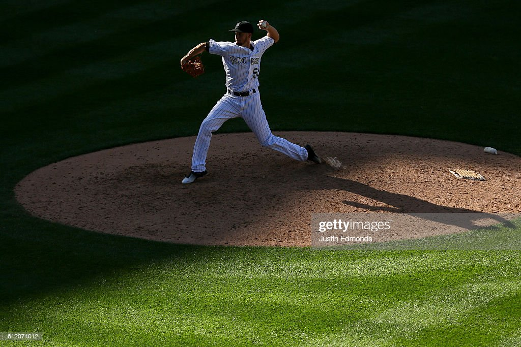 Relief pitcher Chris Rusin #52 of the Colorado Rockies delivers to home plate during the ninth inning against the Milwaukee Brewers at Coors Field on October 2, 2016 in Denver, Colorado. The Brewers defeated the Rockies 6-4. The Rockies finished their season 75-87.