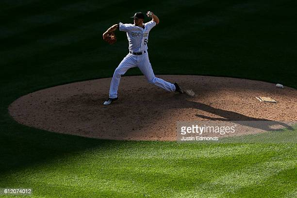 Relief pitcher Chris Rusin of the Colorado Rockies delivers to home plate during the ninth inning against the Milwaukee Brewers at Coors Field on...