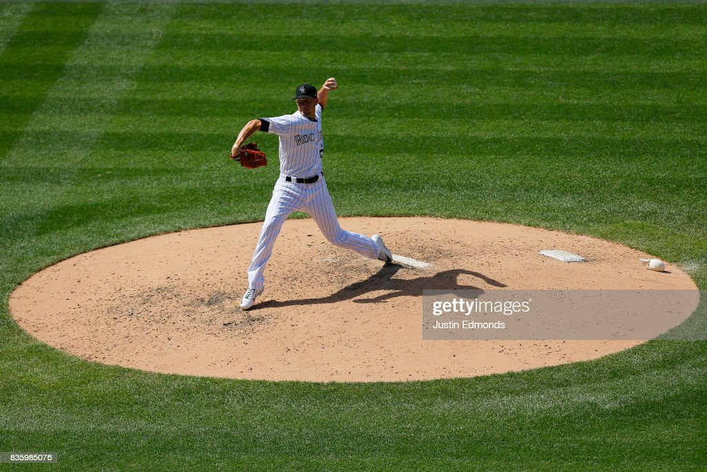 Relief pitcher Chris Rusin #52 of the Colorado Rockies delivers to home plate during the sixth inning against the Milwaukee Brewers at Coors Field on August 20, 2017 in Denver, Colorado.
