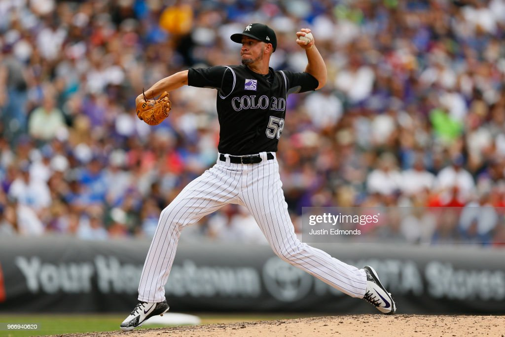 Relief pitcher Chris Rusin #52 of the Colorado Rockies delivers to home plate during the sixth inning against the Los Angeles Dodgers at Coors Field on June 3, 2018 in Denver, Colorado.