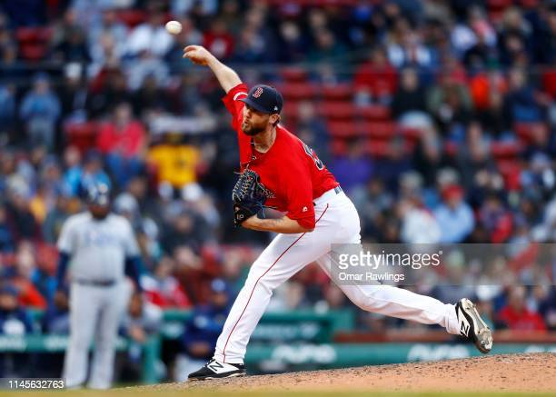 Relief pitcher Colten Brewer of the Boston Red Sox pitches at the top of the eighth inning of the game against the Tampa Bay Rays at Fenway Park on...
