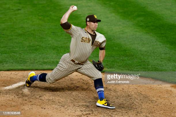 Relief pitcher Craig Stammen of the San Diego Padres delivers to home plate during the ninth inning against the Colorado Rockies at Coors Field on...