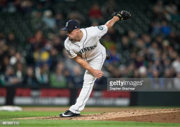 Relief pitcher Dan Altavilla of the Seattle Mariners deliver s a pitch during the seventh inning of a game against the Houston Astros at Safeco Field...