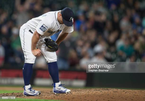 Relief pitcher Dan Altavilla of the Seattle Mariners reacts to giving up a solo home run to JD Martinez of the Detroit Tigers during the eighth...