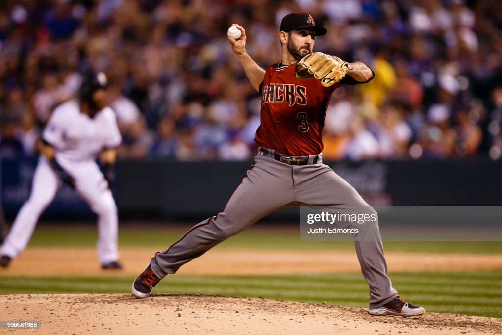 Relief pitcher Daniel Descalso #3 of the Arizona Diamondbacks delivers to home plate during the fourth inning against the Colorado Rockies at Coors Field on July 11, 2018 in Denver, Colorado. Descalso normally plays second base but was brought into the game with the Rockies leading 14-1.