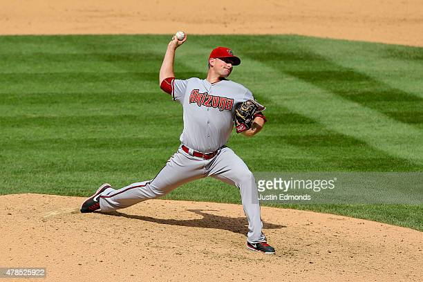 Relief pitcher Daniel Hudson of the Arizona Diamondbacks delivers to home plate during the eighth inning against the Colorado Rockies at Coors Field...