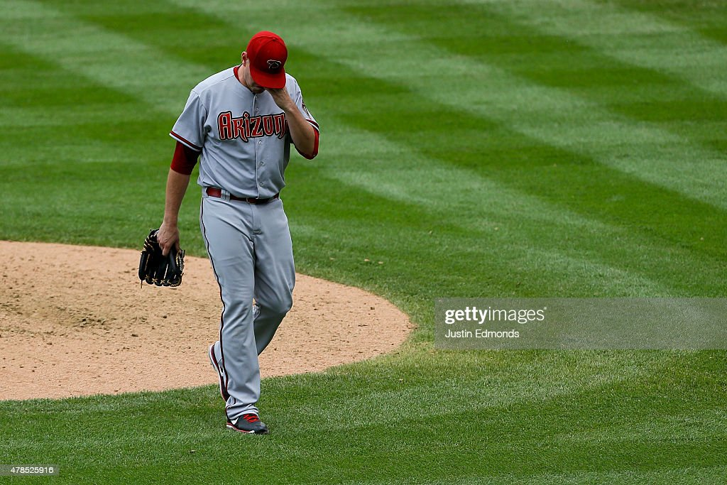 Relief pitcher Daniel Hudson #41 of the Arizona Diamondbacks reacts after being removed from the game during the eighth inning against the Colorado Rockies at Coors Field on June 25, 2015 in Denver, Colorado. The Rockies defeated the Diamondbacks 6-4.