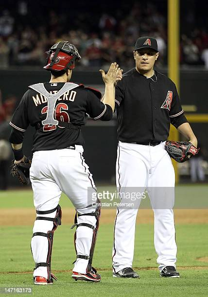Relief pitcher David Hernandez of the Arizona Diamondbacks celebrates with catcher Miguel Montero after defeating the Oakland Athletics in the...