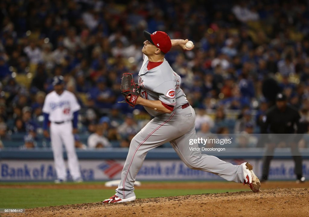 Relief pitcher David Hernandez #37 of the Cincinnati Reds pitches in the seventh inning of the MLB game against the Los Angeles Dodgers at Dodger Stadium on May 12, 2018 in Los Angeles, California. The Reds defeated the Dodgers 5-3.