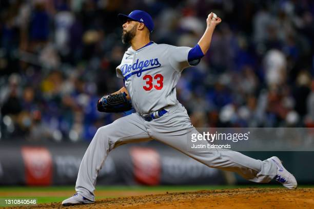 Relief pitcher David Price of the Los Angeles Dodgers delivers to home plate during the seventh inning against the Colorado Rockies at Coors Field on...